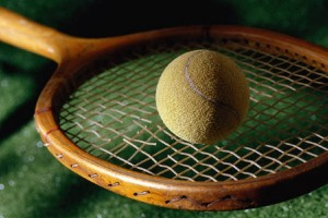 Tennis ball and racket with broken string